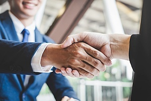 a construction law attorney shaking hands with the owner of a company